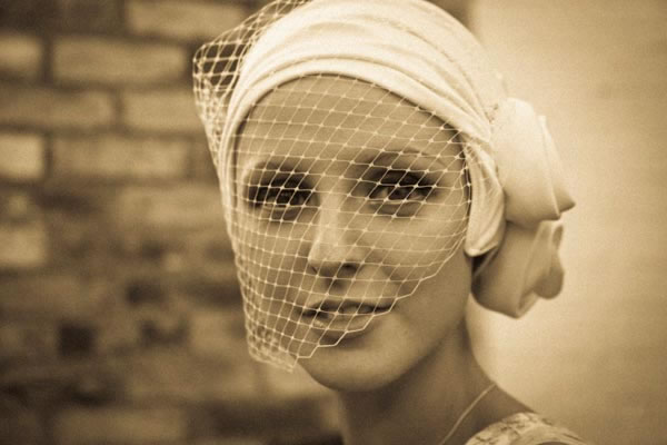 young bride wearing cream turban with veiling to cover alopecia hair loss