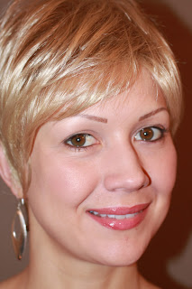 young woman with permanent faux eyebrows and wearing a wig