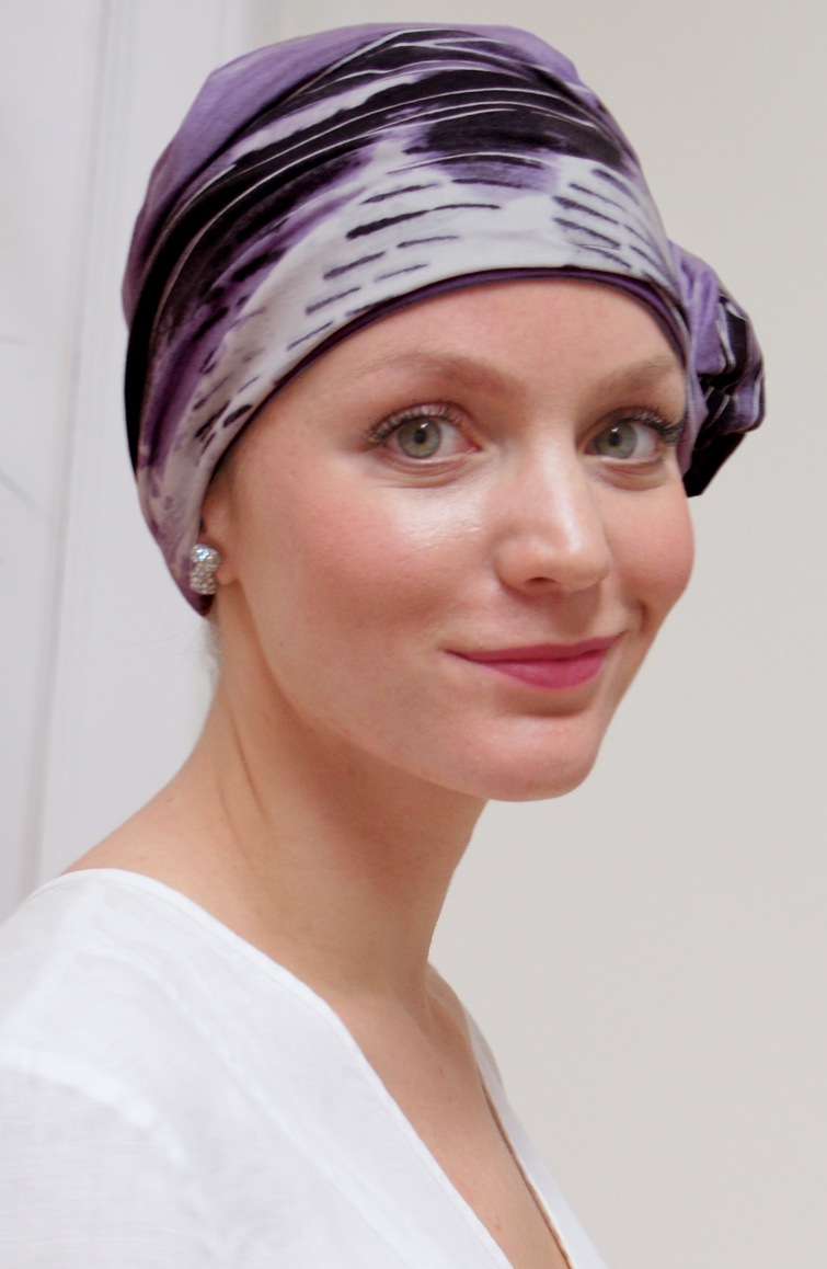 close up of woman smiling wearing mauve chemo turban