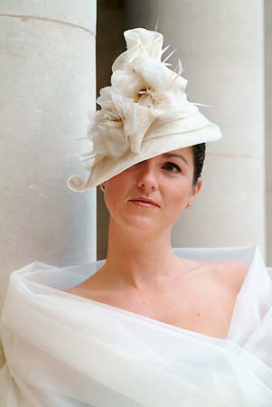 Cream perch hat with handmade silk flowers designed by Nicky Zip