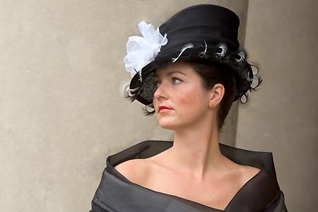 Black 'Ascot' female top hat with black and white feathers