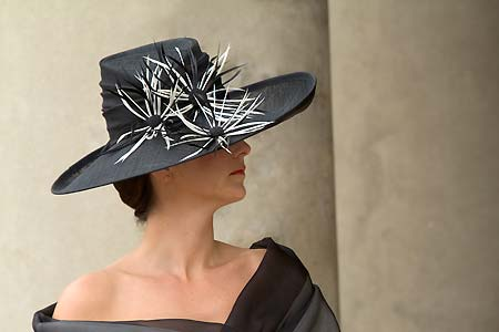 Black picture hat with feather flowers in black and white for Ascot designed by Nicky Zip