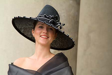 Big brimmed black hat with black and white ribbon trim for Ascot designed by Nicky Zip