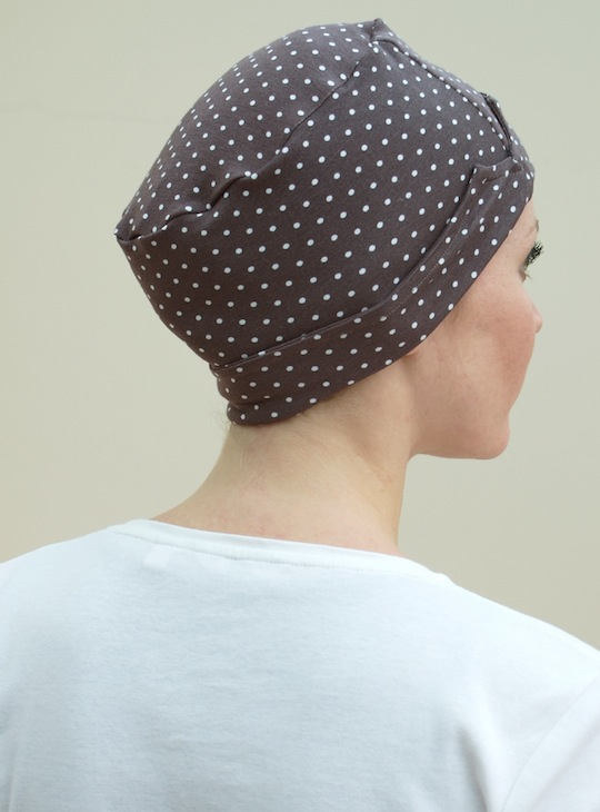 back view of brown spotty sleep hat for chemo hair loss