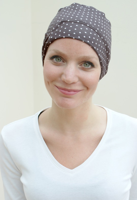 close up of brown spotty chemo sleep hat to keep your head warm with hair loss