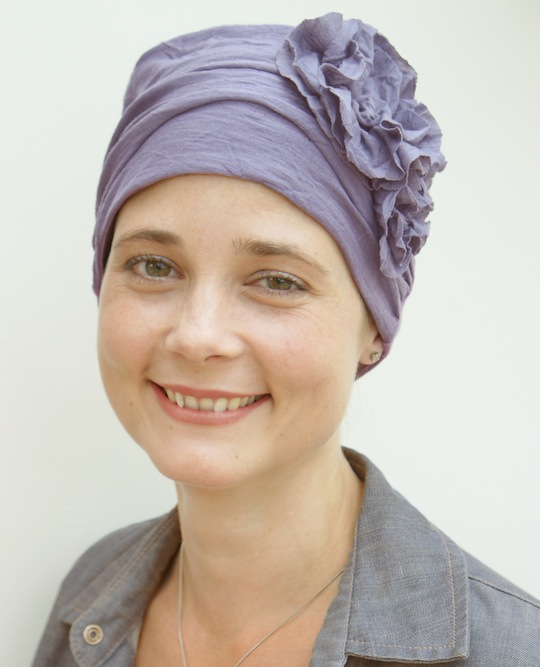 mauve turban hat with pretty mauve flower on the side