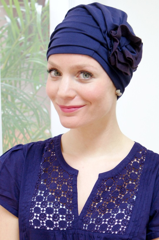 Woman wearing royal purple fashion turban