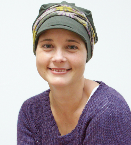 young women in green cap for female hair loss smiling