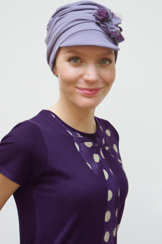 young woman in mauve chemo cap