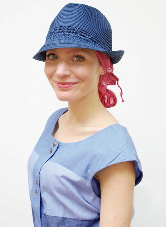 women wearing blue trilby summer hat and sun dress