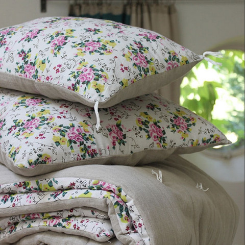 floral bedding cushions and quilt on couch