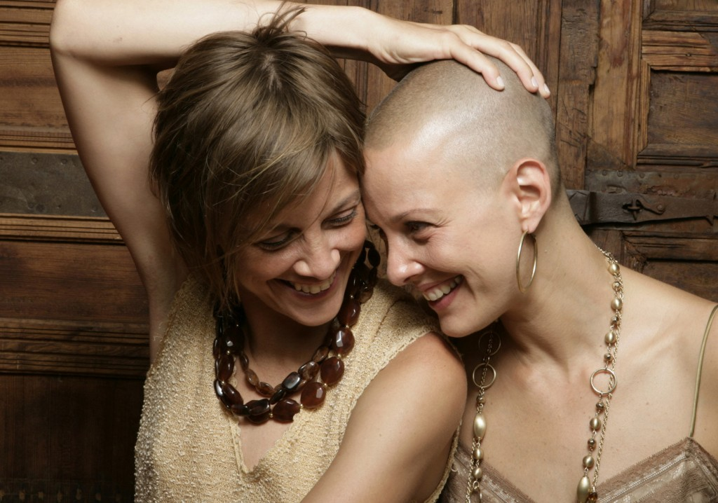 Two sisters supporting each other through hair loss