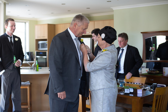 Angie at her son's wedding day with husband