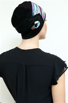 back view of black hat on woman wearing black dress