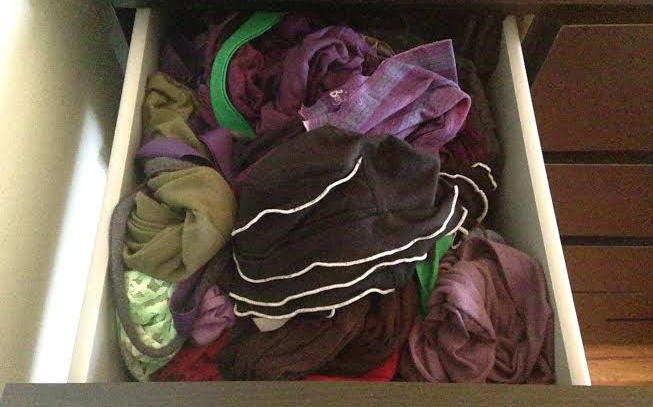 drawer full of hats and scarves