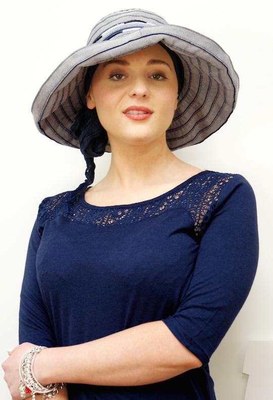 woman wearing wide brimmed blue summer hat