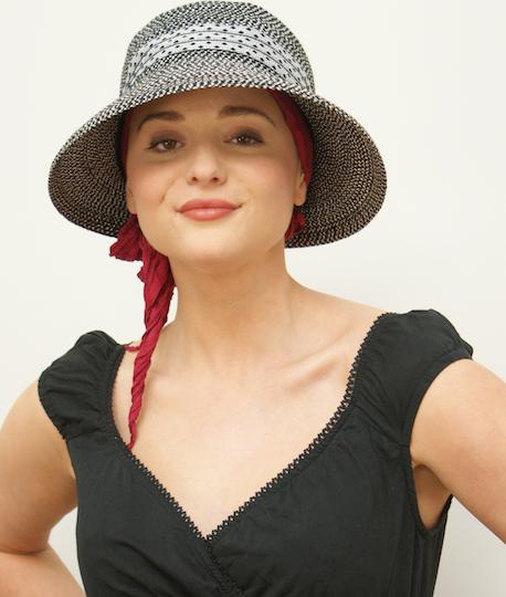 black and white summer hat on model wearing black sun dress