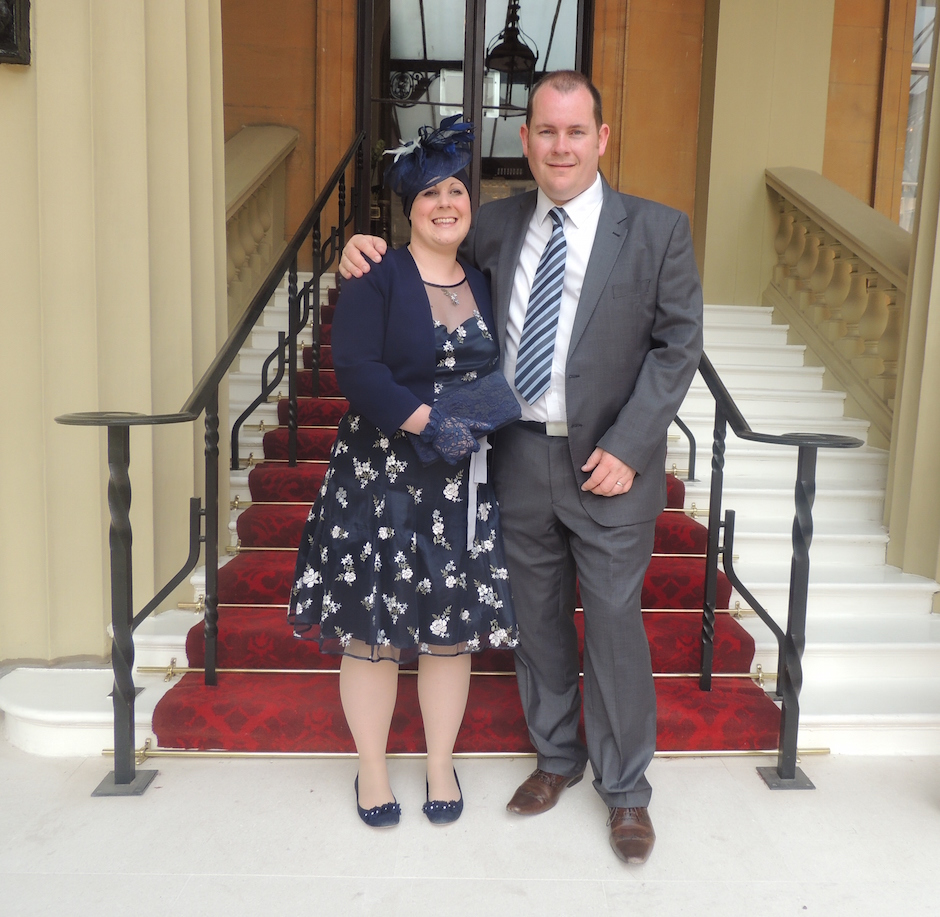 doctor with her husband receiving MBE at Buckingham Palace