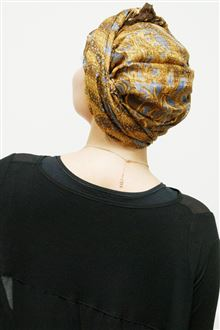 Back view of gold silk evening head scarf worn with black dress