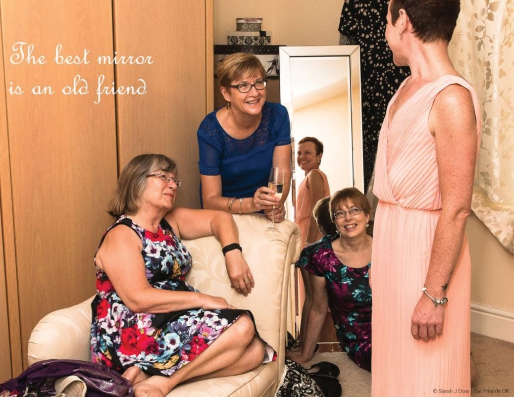 women in trying on dresses after a mastectomy